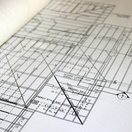 close-up-of-blueprint-on-construction-table